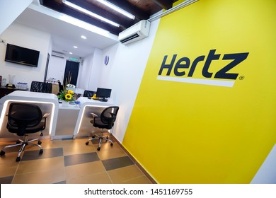 PENANG, MALAYSIA - JULY 05, 2019 : Hertz logo on a wall at customer service center. Hertz is an American car rental company with international locations in 145 countries worldwide.