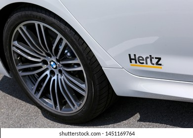 PENANG, MALAYSIA - JULY 05, 2019 : Hertz logo on a luxury BMW car. Hertz is an American car rental company with international locations in 145 countries worldwide.