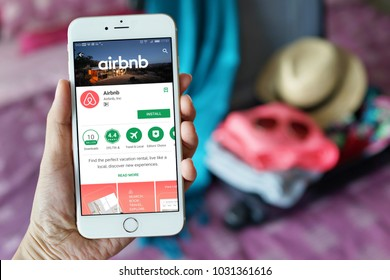 Penang, Malaysia - July 12, 2017: Female hand holding smartphone with Airbnb application. Airbnb is an online marketplace and hospitality service, enabling people to lease or rent short-term lodging