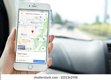 Penang, Malaysia - July 12, 2017: Female hand holding smartphone displaying Google Maps