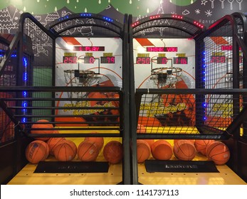 "Penang, Malaysia - July 14, 2018: Front view of a basketball arcade machine named ""Street Basketball"" at Aeon Queensbay"