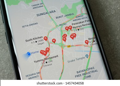 Penang, Malaysia - July 19, 2019: Smartphone with Google Maps service on the screen. Google Maps is most popular mapping service for mobile provided by Google.