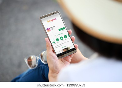PENANG, MALAYSIA - July 20, 2018: Women hand holding smartphone with Instagram application on the screen. Instagram is a photo-sharing app for smartphones.