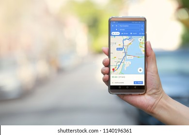 PENANG, MALAYSIA - July 20, 2018: Women hand holding smartphone with Google Maps service application on the screen. Google Maps is most popular mapping service for mobile provided by Google.