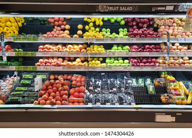 PENANG, MALAYSIA - JULY 25, 2019: Interior view of huge glass freezer with various fresh fruits and vegetables in Aeon store. Aeon is is Japan's single-largest shopping mall developer and operator.
