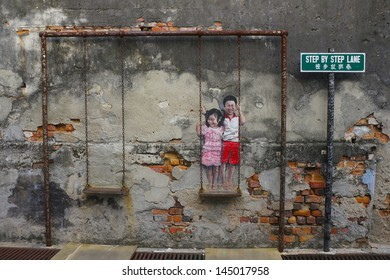 PENANG, MALAYSIA- JULY 6: Street Mural tittle 'Children on the Swing' painted by Louis Gan in Penang on July 6, 2013. It was painted in conjunction with the 2012 George Town Festival.