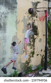 PENANG, MALAYSIA- JULY 6: Street Mural tittle 'Children Playing Basketball' painted by Louis Gan in Penang on July 6, 2013. It was painted in conjunction with the 2012 George Town Festival.