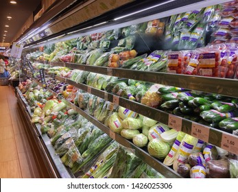 Penang, Malaysia - Jun 15, 2019 : Row of shelves fill with assorted fresh vegetables for sale at Aeon Queensbay Mall