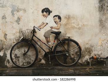 PENANG, MALAYSIA - JUN 15: Street Mural entitled 'LIttle Children on a Bicycle' painted by Ernest Zacharevic in Penang on June 15, 2013.