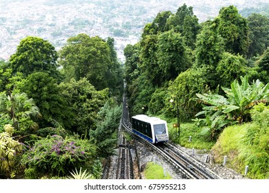 PENANG, MALAYSIA - JUNE 17, 2017: a train moving to the top of penang hill. the train track is surrounded with dense jungle