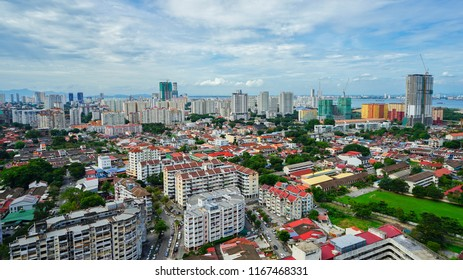 Penang, Malaysia - June 1st 2018: An aerial view of residential houses against backdrop of new high rise condominiums in Jelutong district.