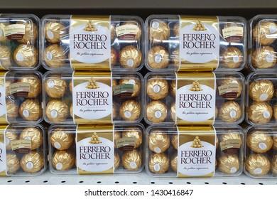 PENANG, MALAYSIA - JUNE 20, 2019: Stack of Ferrero Rocher premium chocolate box on store shelf. Ferrero Rocher is a spherical chocolate produced by the Italian chocolatier Ferrero SpA.