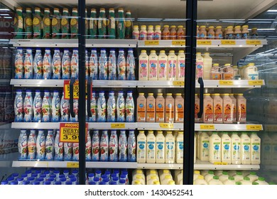 PENANG, MALAYSIA - JUNE 20, 2019: Interior view of huge glass fridge with various brand beverage in Giant grocery store, Penang. Giant is a famous and trusted supermarket brand in Malaysia.