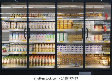 PENANG, MALAYSIA - JUNE 20, 2019: Interior view of huge glass fridge with various brand foods and beverage in Giant grocery store, Penang. Giant is a famous and trusted supermarket brand in Malaysia.