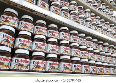 PENANG, MALAYSIA - JUNE 20, 2019 : Rows of Nutella hazelnut spread on store shelves. Nutella is the brand name of a sweetened hazelnut cocoa spread. Manufactured by the Italian company Ferrero.