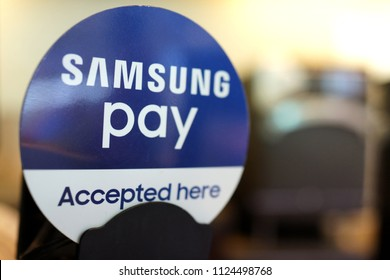 PENANG, MALAYSIA - JUNE 28, 2018:  Samsung Pay Accepted Here sign in airport shopping store. Samsung Pay is a mobile payment and digital wallet service by Samsung Electronics.