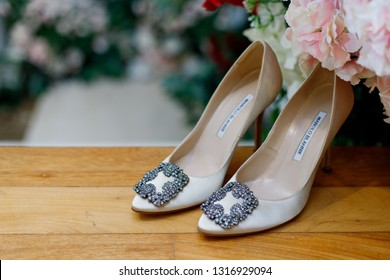 PENANG, MALAYSIA - JUNE 4, 2017: Elegant bridal shoes designed by Manolo Blahnik. Manolo Blahnik is an Spanish fashion label designed and founder of the eponymous high-end shoe brand.