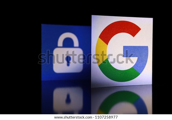 PENANG, MALAYSIA - JUNE 6, 2018: Google security and privacy issues. Close up Google logo with the security lock icon isolated on black background.