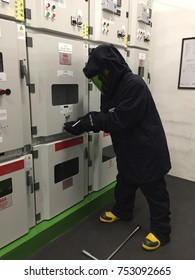 Penang, Malaysia. Mach 11, 2017. Electrical competant  person switching electric panel with electrical safety jacket or switching suits or safety wear at switchgear room.