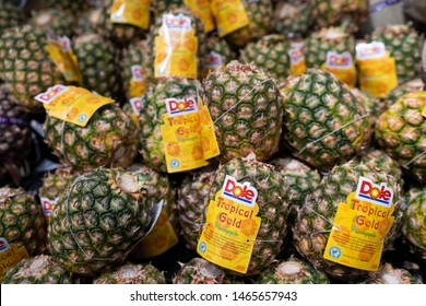 PENANG, MALAYSIA - Mar 09, 2019 - Dole pineapple display in the supermarket. Dole Food Company, Inc. is an American agricultural multinational corporation headquartered in Westlake Village, California