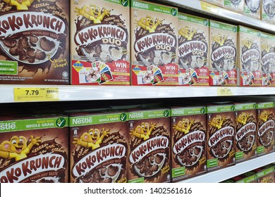 PENANG, MALAYSIA - MAR 15, 2019: Nestle band of breakfast cereals on store shelf. Breakfast cereal is a breakfast food made from processed cereal grains and often mixed with milk, yogurt and fruit.