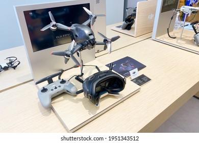PENANG, MALAYSIA - MAR 31, 2021: DJI FPV Drone set with controller and Goggles display in DJI showroom.