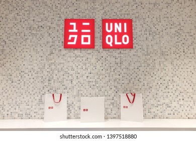 PENANG, MALAYSIA - MAR 7, 2019: Interior view of Uniqlo fashion store in shopping mall. Uniqlo Co., Ltd. is a Japanese casual wear designer, manufacturer and retailer.