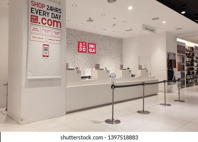 PENANG, MALAYSIA - MAR 7, 2019: Interior view of cashier counter of Uniqlo fashion store in shopping mall. Uniqlo Co., Ltd. is a Japanese casual wear designer, manufacturer and retailer.