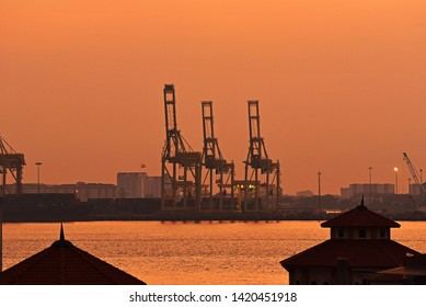 PENANG, MALAYSIA - MARCH 03rd, 2019 : Sunrise over the Penang Port in Penang, Malaysia. Background of crane containers. Penang Port is the oldest and longest established port in Malaysia.
