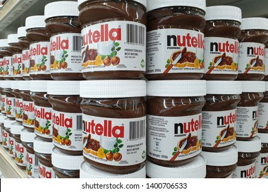 PENANG, MALAYSIA - MARCH 15, 2019 : Jar of Nutella hazelnut spread on store shelves. Nutella is the brand name of a sweetened hazelnut cocoa spread. Manufactured by the Italian company Ferrero.