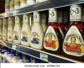 PENANG, MALAYSIA - MARCH 18, 2017: Newman's Own products in squeezable plastic bottles consisting of ranch, mayonnaise, sun dried tomato, and caesar display on supermarket shelf.