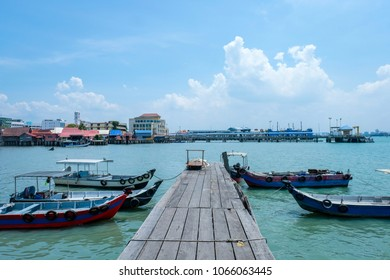 Penang, Malaysia - March 23, 2018 : Chew Jetty which is one of the UNESCO World Heritage Site in Penang.People can seen walking and exploring around it.