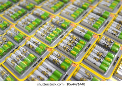 PENANG, MALAYSIA - MARCH 28, 2018: Stack of GP Super Alkaline AA batteries with Minions cartoon printed selling on store shelf. Gold Peak Group in Hong Kong, GP Batteries product.