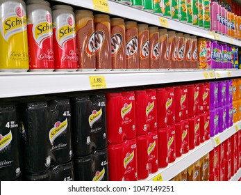 PENANG, MALAYSIA - MARCH 6, 2018: Various of soft drinks and soda water on the hypermarket shelves. Among them are A&W, Schweppes, Coca-Cola, F&N and Mirinda