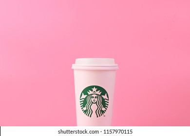 PENANG, MALAYSIA - MAY 1, 2018: White coffee cup with Starbucks logo on pink background. Starbucks is the world's largest coffee house with over 20,000 stores in 61 countries.