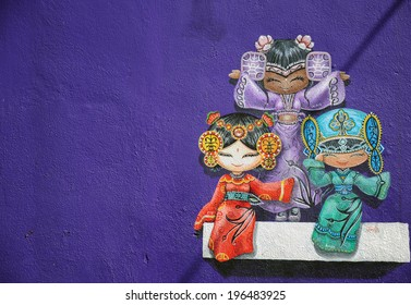 PENANG, MALAYSIA- MAY 12, 2014 : Wall grafitti of three chinese dolls, Penang Malaysia. These wall graffitti has gained reputation and become part of Penang tourist attractions.