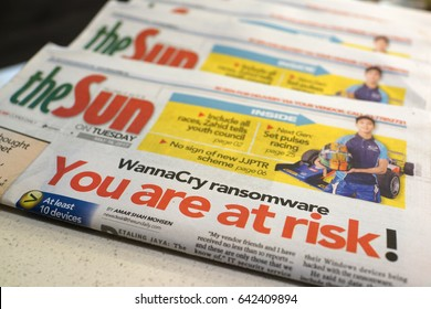 PENANG, MALAYSIA - MAY 16, 20137: Free copy of The Sun newspaper in Mc Donals restaurant. The headlines announce the Malware Ransomware wannacry virus attack worldwide.