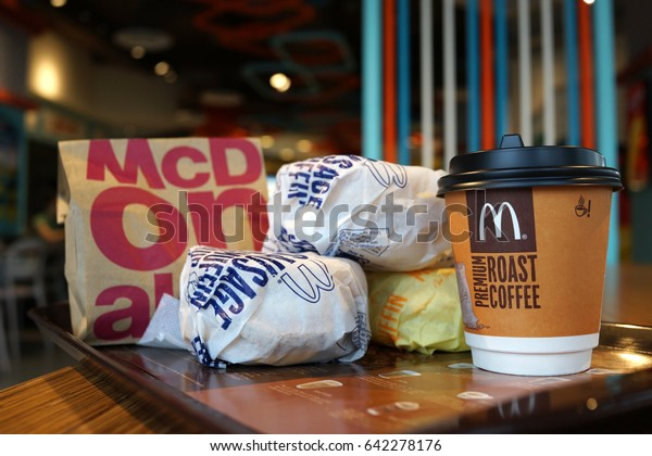 PENANG, MALAYSIA - MAY 16, 2017 : Egg McMuffin with McDonald Premium Roast Coffee is one of the meals choice at McDonald's Weekday Breakfast Specials.