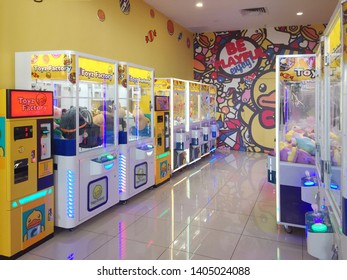 Penang, Malaysia - May 20, 2019 : Rows of claw game machines in an arcade area at First Avenue Mall