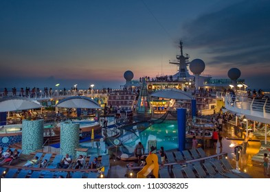 Penang, Malaysia - May 8 2018: the view of the  upper deck of Onboard Voyager of the Seas, Royal Caribbean International at the sunset.