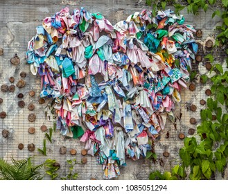PENANG, MALAYSIA, NOV 12 2017, symbol of heart from tied scarf on wall of house. Heart shaped decorations. Street art in Penang.