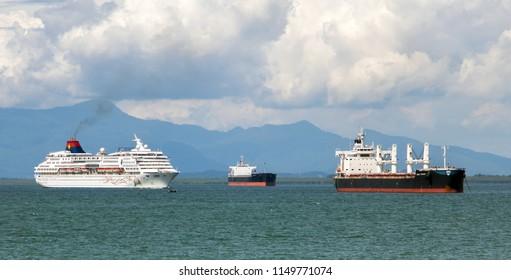 PENANG, MALAYSIA, NOV 13 2017, Shipping at sea on Penang Island. The cruise ship sails around the anchor tanker.