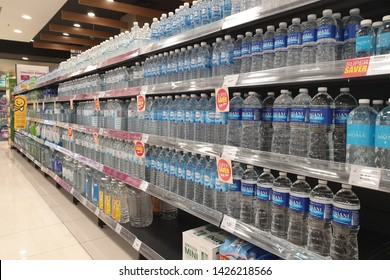 PENANG, MALAYSIA - NOV 23, 2018: Bottles with pure fresh mineral water on shelves in AEON grocery store. AEON is the largest retailer in Asia, formerly known as JUSCO supermarkets.