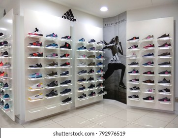 PENANG, MALAYSIA - NOV 24, 2017: Adidas shoes in shoe store display. It is a German multinational corporation that designs and manufactures sports clothing and accessories based in Germany.