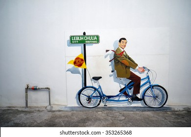 PENANG, MALAYSIA - NOV 26, 2015: View of a mural Mr. Bean character on a tandem bike painted by Liew Wai Keat at Chulia Street, George Town on December 12, 2015.