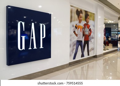 PENANG, MALAYSIA - NOVEMBER 10, 2017: Gap Kid's fashion store in shopping mall. Gap is an American worldwide clothing and accessories retailer.