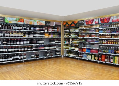 PENANG, MALAYSIA - NOVEMBER 16, 2017: An assortment of wine and hard liquor bottles stacked neatly on store shelves in a local supermarket, Penang, Malaysia