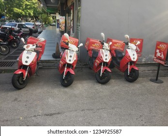 Penang, Malaysia - November 20, 2018 : View of a fleet of KFC (Kentucky Fried Chicken) electric motorcycle park infront of a KFC outlet ready for delivery at Ayer Itam