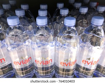Penang, Malaysia - November 25 2017 : Evian brand mineral water bottles in a shelf at a supermarket. Evian is a famous mineral water brand.