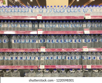 Penang, Malaysia - November 3, 2018 : Rows of Top Valu brand distilled mineral water for sale on shelves at Aeon Supermarket Queensbay